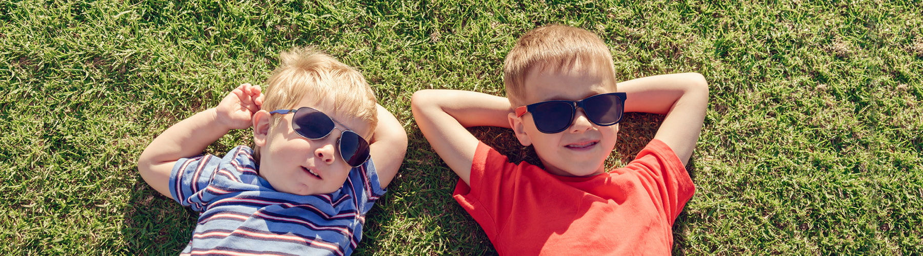 two children wearing sunglasses