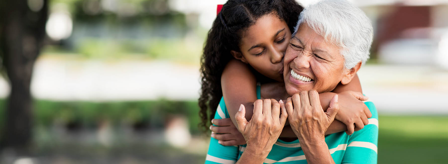 Grandmother and graddaughter embrace
