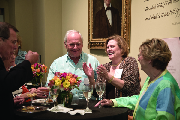 Dr. Edward Gore of Tupelo, Class of 1964, and his wife Claudia Gore enjoy a moment with friends.