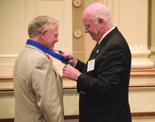 Dr. Ed Hill of Tupelo, left, receives his Class of 1964 commemorative medal from Dr. James Keeton, vice chancellor for health affairs and dean of the School of Medicine, shortly before addressing his fellow alumni.