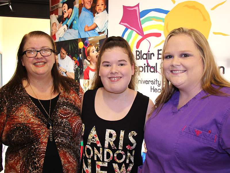 Vicksburg resident Hannah Dunaway, center, was named the 2015 Children's Miracle Network Champion for Batson Children's Hospital in Jackson during a celebration at the Marriott Courtyard in Vicksburg. She's pictured with her mom, Nicki Dunaway, left, of Vicksburg, and her longtime nurse at Batson, Ashley Arceo.