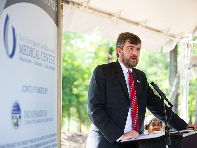Dr. Damon Darsey, associate professor of emergency medicine and medical director of the Mississippi Center for Emergency Services, explains the center's mission during groundbreaking ceremonies.