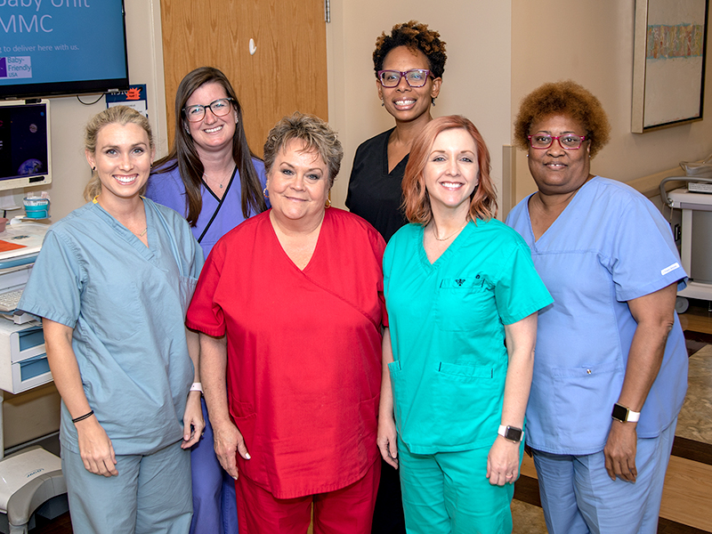 UMMC's team of International Board Certified Lactation Consultants includes front row from left, Laurie McHenry, RN; Cheryl Lloyd, RN; Lauren Ryan, RN; Evora Knight, RN; back row, Marci Talbot, registered dietician and Valerie Stingley, RN.