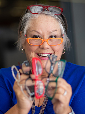Susan O'Bryan displays several of her 42 pairs of reading glasses.