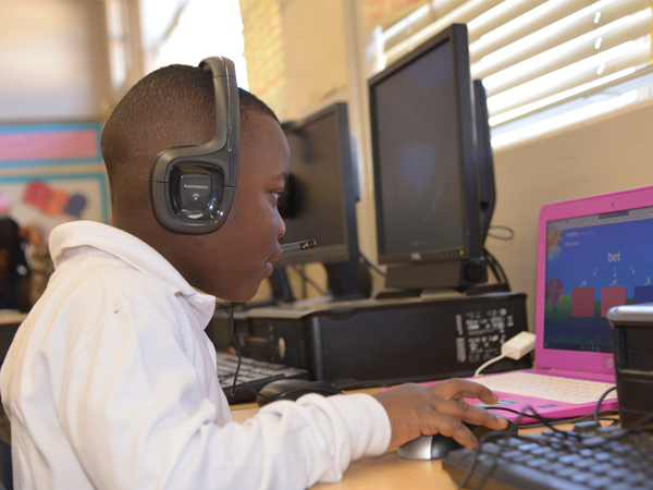 Raines Elementary first-grader D'Ashtyn Minor participates in his 30-minute tutoring session with the TutorMate program.