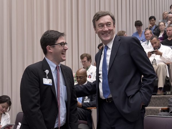 Noseworthy (right) shares a laugh with Dr. Peter Arnold, associate professor of plastic surgery.