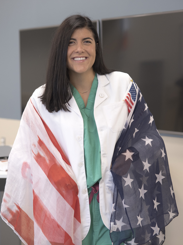 Among Sara's possessions that symbolize her newly adopted country is this scarf with a U.S. flag theme