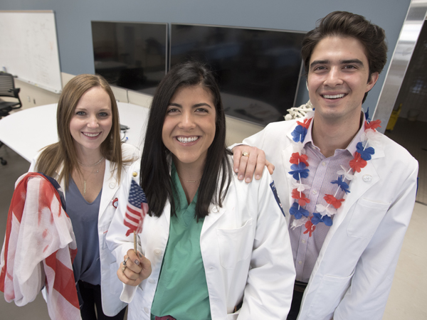 Among those who have celebrated Sara's U.S. citizenship are her friends and fellow M1s Kathryn Wegener, left, of Jackson and John Bobo of Clarksdale.