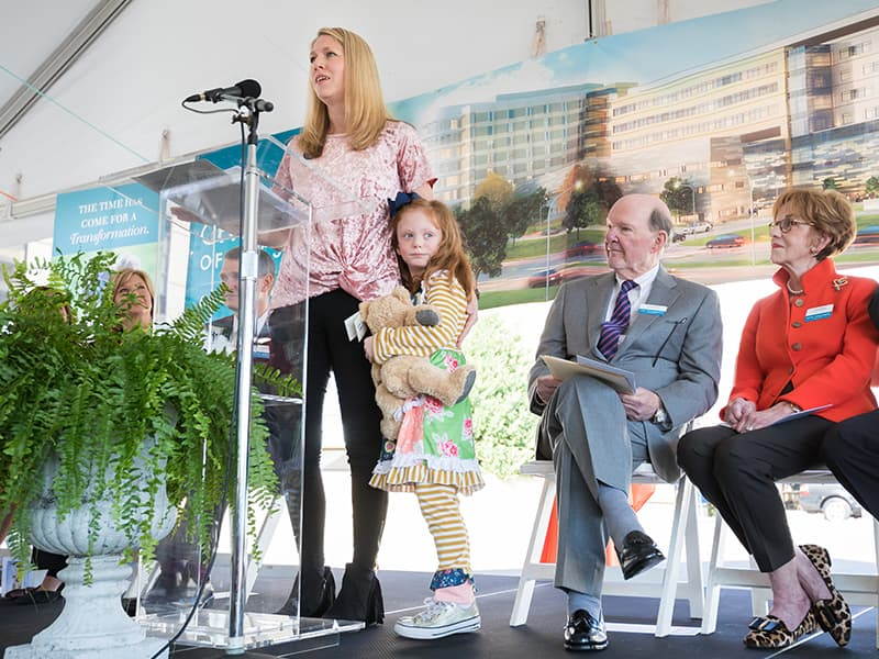 Megan Bell of Pearl tells her daughter Avery's story during the groundbreaking for a new children's tower.