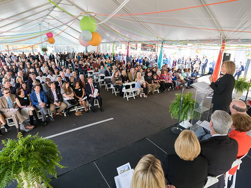 Hundreds of state leaders, philanthropists, medical professionals, patients and their families listen as Dr. LouAnn Woodward, vice chancellor for health affairs and dean of the School of Medicine, speaks during the groundbreaking ceremony Friday.