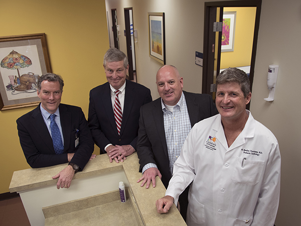 Smiling at the opening of the new Children's of Mississippi specialty clinic on the Gulf Coast are, from left, Dr. Rick Barr and Dr. John Purvis from UMMC and Dr. Mark Lee and Dr. Brad Troutman, who will practice at the clinic, located in Biloxi's Cedar Lake area.
