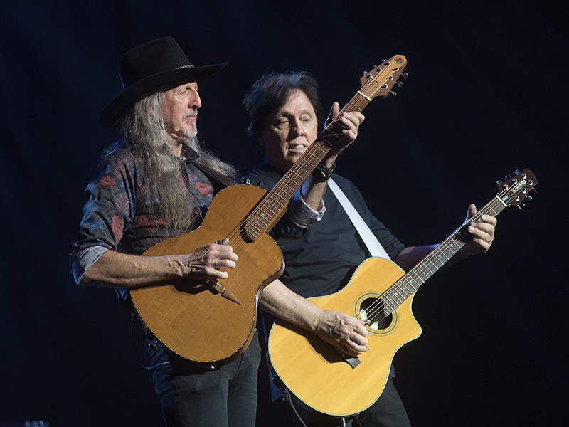 Pat Simmons, left and John McFee of The Doobie Brothers play acoustic guitar.