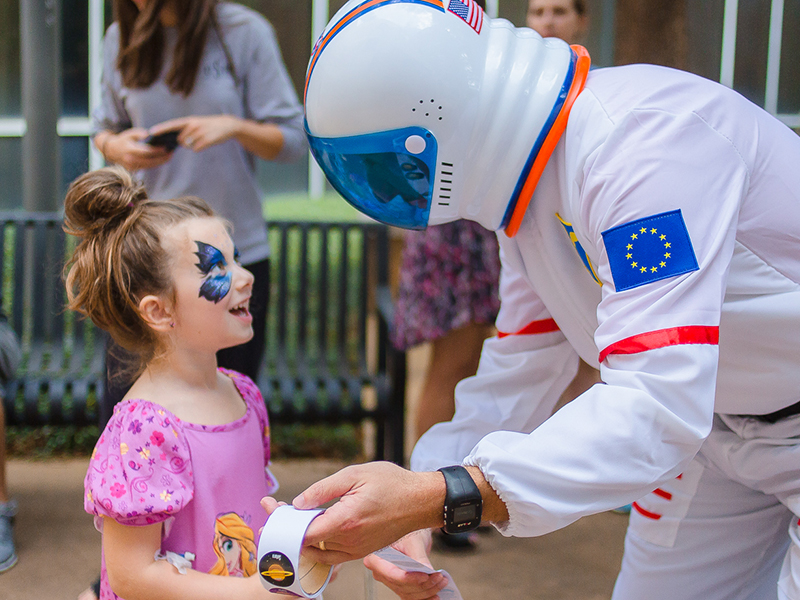 Batson Children's Hospital patient Emma Reynolds gets a sticker from an astronaut during the space-themed Mississippi Children's Museum Day at the hospital. The annual event is in its second year.