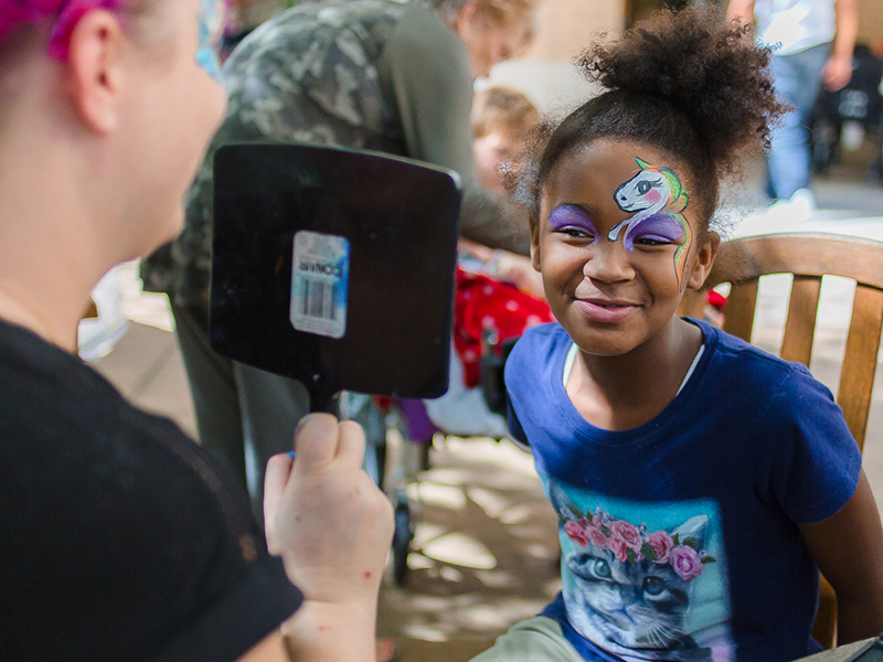 Shyenna Johnson of Greenville, a Batson Children's Hospital patient, shows her unicorn face paint during Mississippi Children's Museum Day at the hospital.