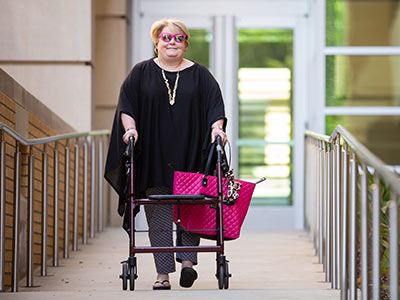 Tammy Dempsey, director of community engagement and service learning in the Office of Academic Affairs, walks to and from the office instead of riding the bus.