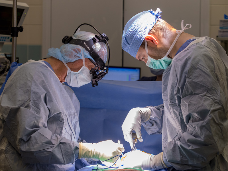 Dr. Robert McGuire, left, and surgery resident Dr. Fuller McCabe perform a spinal procedure.
