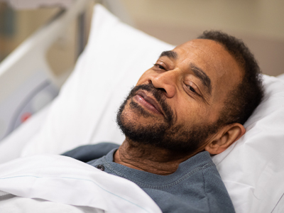Patient smiling while in bed.