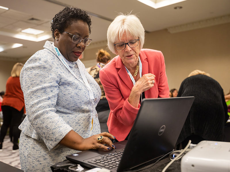 Dr. Mobolaji Famuyide, left, and Dr. Paula Meier of Rush University confer prior to an Express Yourself training session with the Mississippi Perinatal Quality Collaborative.