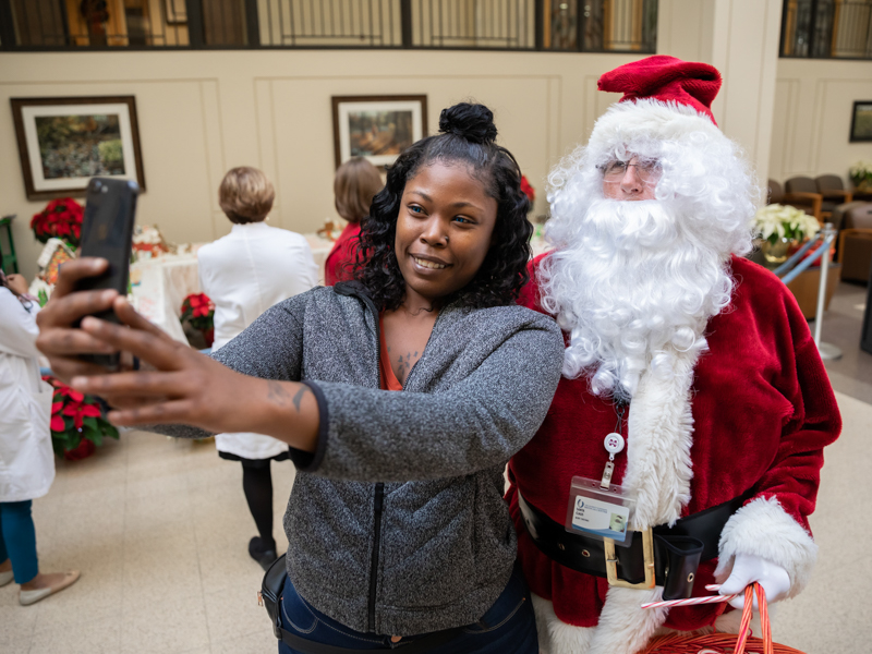Alexis Jones of Jackson pauses to snap a selfie with Santa Claus while at UMMC to visit a patient.