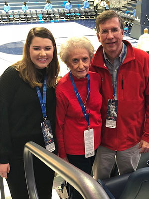 Photo of tucker with his mother and daughter.