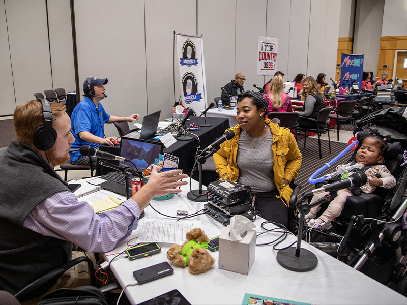 Gerica Hill tells Q101's Ryan Johnson of daughter Gracen O'Harrell's medical journey during Mississippi Miracles Radiothon.