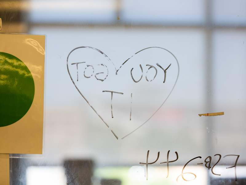 "A handwritten note on MICU patient's window assures him that ""you got it."""