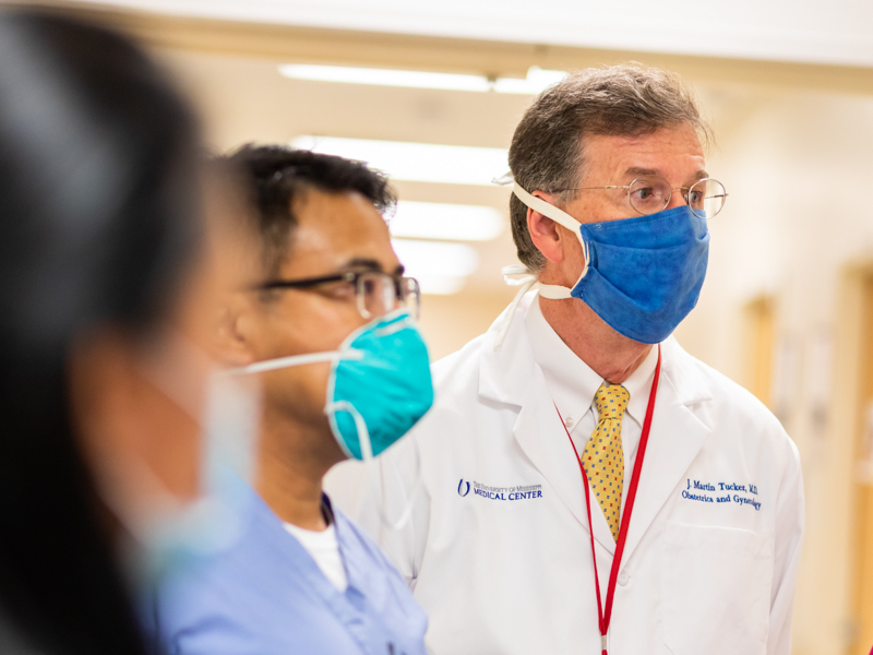 Dr. Marty Tucker, professor and chair of the Department of Obstetrics and Gynecology, takes part in rounds on the Labor and Delivery floor.