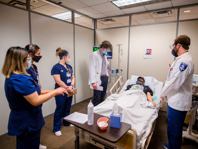 Listening to Pete, voiced by assistant professor of nursing Nikki Lee, are, from left, pharmacy student Xingyu Pan, nursing students Madeline Nicosia and Weslee Patti, and medical students Luke Wojohn and and Johnathan Breaux.