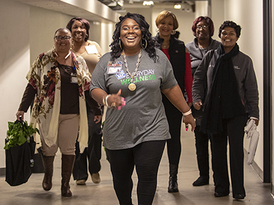 Makeba Smith-Harris, billing specialist at UMMC's Clinton Billing Office, leads a group of colleagues on a wellness walk.