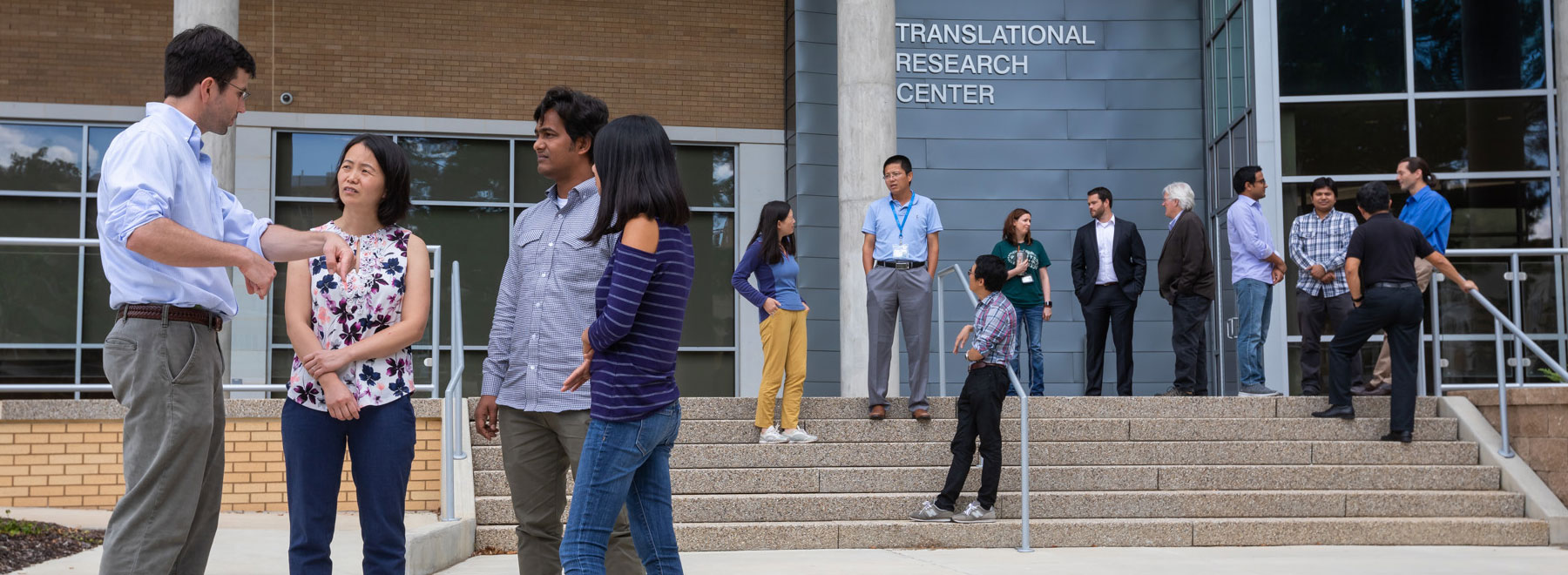 Students and faculty in front of the Translational Research Center