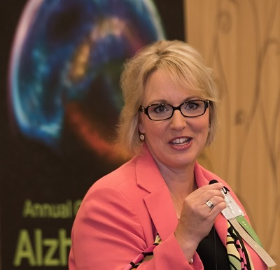 A female speaks during an Alzheimer's conference