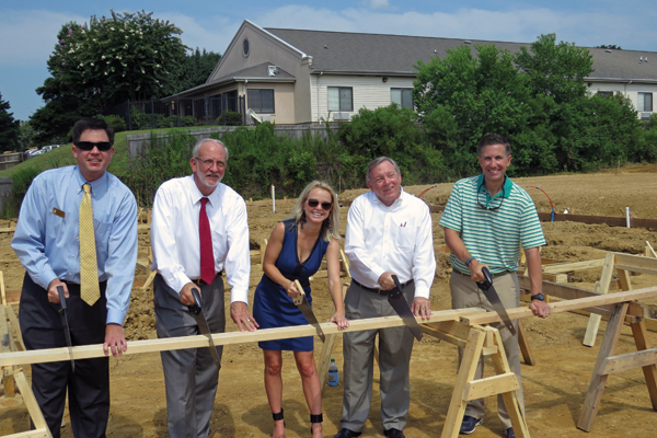 Cutting the first board for framing the 2014 MiracleHome are, from left, Mark Petro, Ridgeland Chamber of Commerce president, Gene McGee, Ridgeland mayor, Leigh Reeves, Friends president, George Gunn, Trustmark executive vice president and Scott Shoemaker, builder.