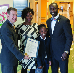 Children's of Mississippi CEO Guy Giesecke (left) accepts a proclamation declaring November 14 as Batson Children's Day from Jackson Mayor Tony Yarber, his wife Rosalind Yarber, and their daughter, Toni Michelle.