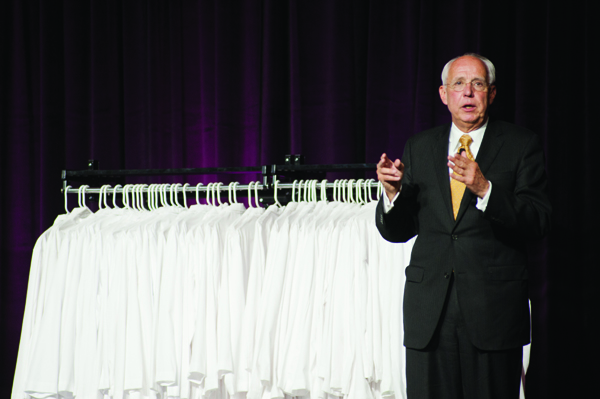 Dr. Darrell Kirch, president and CEO of the Association of American Medical Colleges, speaks to the School of Medicine's Class of 2014 during the May 22 Long Coat Ceremony.