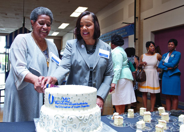 Dr. Myrlie Evers-Williams, left, cuts a cake to celebrate the dedication of the institute named in her honor during a ceremony at the Jackson Medical Mall in Jackson on June 13: the UMMC Myrlie Evers-Williams Institute for the Elimination of Health Disparities. Assisting her is Dr. Bettina Beech, executive director of the institute and associate vice chancellor for population health.