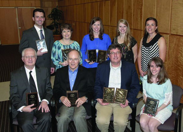 Evers Awards  recipients include, seated from left, Dr. Bela Kanyicska, M1 Professor of the Year; Dr. Davis Manning, representing the M1 Department of the Year: the Department of Physiology; Dr. Stephen Stray, M2 Professor of the Year and representing the M2 Department of the Year: Microbiology; and Dr. Savannah Duckworth, third-year Resident of the Year; and standing from left, Dr. Corey Jackson, M3 Attending of the Year; Jan Simpson, M3 Course Administrator of the Year; Dr. Michelle Horn, representing the M3 and M4 Department of the Year: the Department of Medicine; Dr. Lyssa Weatherly, Fourth-year Resident of the Year; and Dr. Lisa Didion, M4 Attending of the Year.