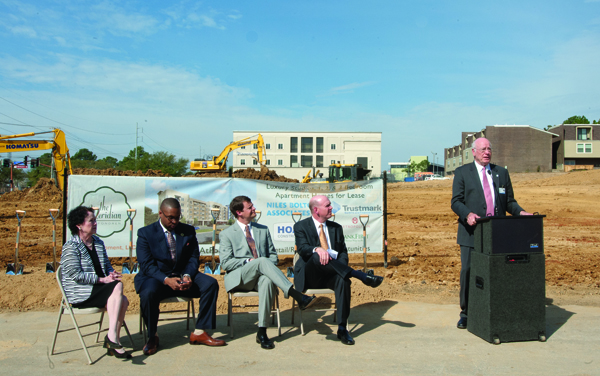 Former University of Mississippi Medical Center Vice Chancellor Dr. James Keeton, at podium, welcomes visitors to the groundbreaking ceremony for the Meridian, a $33 million apartment home development on Lakeland Drive across from the UMMC campus. Joining him are, from left, Jackson Ward 7 Councilwoman Margaret Barrett-Simon; Jason Goree, city of Jackson economic developer; John Ditto, a partner in the StateStreet Group; and Stewart Speed, a partner in SKD Development.