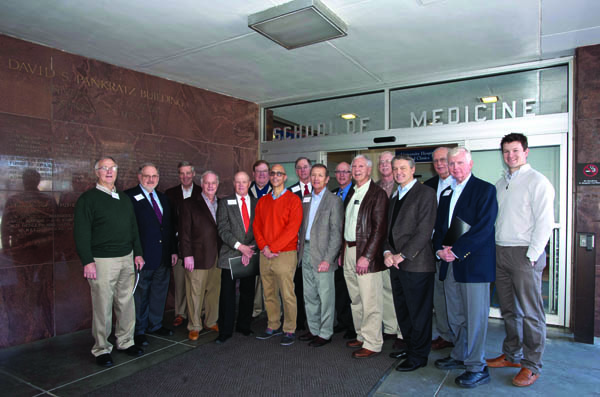 During a tour of the campus, reunion attendees stopped by the School of Medicine. They are, from left, Dr. Buddy Meyer; Dr. Pat Barrett; Dr. John Purvis; Dr. Mitch Massey; Dr. Bill Edwards; Dr. David Gandy; Dr. George Russell, chair of the Department Orthopaedic Surgery and Rehabilitation; Dr. John Drake; Dr. Robert Marascalco; Dr. Bill Marshall; Dr. Tom Jeffcoat; Dr. Bill Stewart; Dr. Doug Rouse; Dr. Gene Barrett; Dr. Hugh Brown; and current orthopaedic surgery resident Dr. Jimbo Moss.