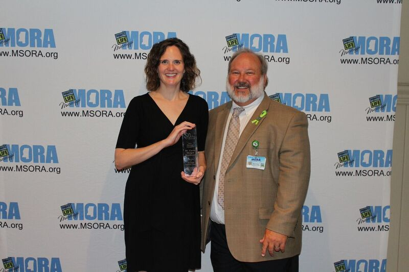 Henderson receives her Spero from Kevin Stump, MORA CEO