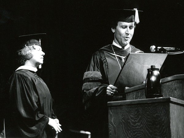 Graham listens to a reading of her retirement citation by then-Chancellor Dr. R. Gerald Turner during commencement. Graham retired officially on June 30, 1986 after 31 years of service at the Medical Center.
