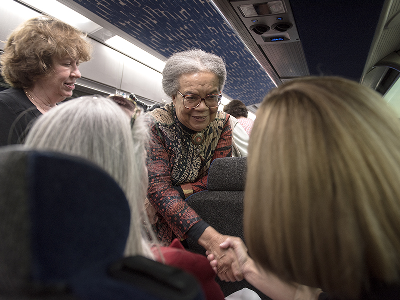 Edelman, center, greets  School of Nursing Dean Dr. Kim Hoover (right) and Dr. Janet Harris, School of Nursing associate dean for practice and community engagement, aboard a tour bus. Looking on is Dr. Lessa Phillips, former UMMC Department of Family Medicine chair and now chief medical officer of United Healthcare Community Plan Mississippi.