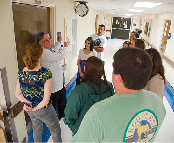 Leading a Millsaps College history class on a historical tour of UMMC in April 2014, Didlake shows students the original ER area where civil rights leader Medgar Evers was brought after he was shot in June 1963.
