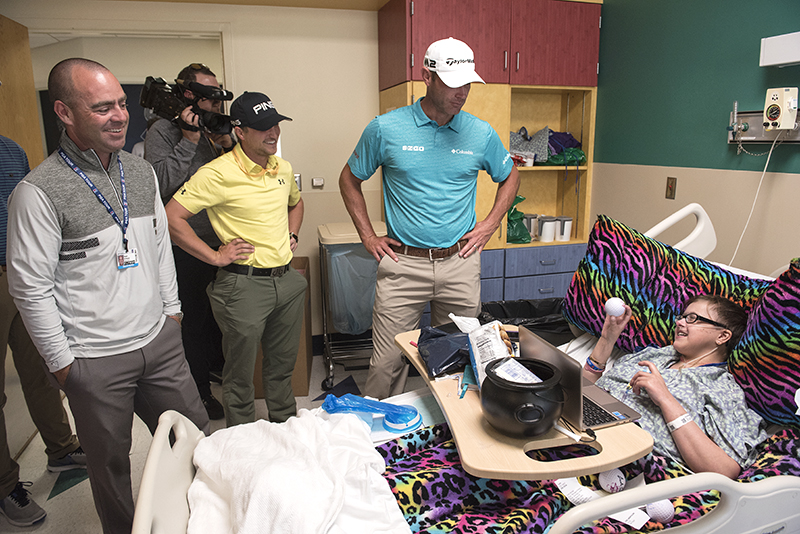 Samantha York of Meridian, a Batson Children's Hospital patient,  gets a souvenir golf ball from Sanderson Farms Championship competitors, from left, Ryan Armour, Austin Cook and Shawn Stefani. Armour was the winner of the Sanderson Farms Championship.
