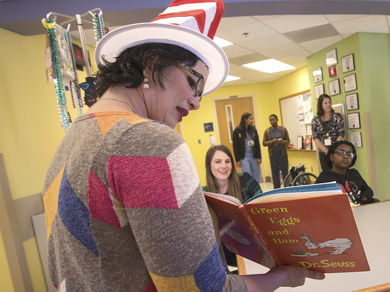 "Hospital school teacher Pam Parks-McCord reads ""Green Eggs and Ham"" to Batson Children's Hospital patients as a celebration of Dr. Seuss' birthday. The beloved children's author was born March 2, 1904."