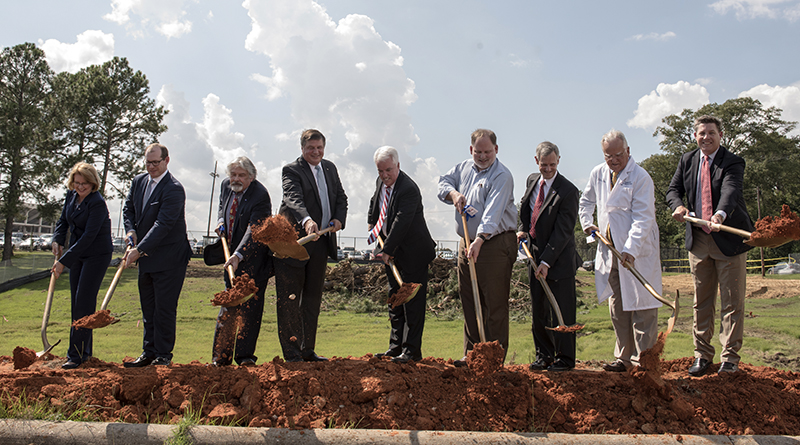 The shovels made it official. The first throw of the dirt was taken by those who have worked to build the American Cancer Society Hope Lodge and representatives of hospitals whose patients will use it. From left are, Sheila Grogan, Blue Cross/Blue Shield of Mississippi; Kirk Sims, Yates Construction; Dr. Ralph Vance, professor emeritus, UMMC, and ACS Capital Campaign Committee member; Jerry Host, president and CEO of Trustmark Corporation and Capital Campaign Committee chair; Mike Neal, ACS executive vice president; John Lewis, Gertrude C. Ford Foundation director; Claude Harbarger, president of St. Dominic Health Services; Dr. John Ruckdeschel, UMMC Cancer Institute director; Whit Hughes, Baptist Health Services Foundation.