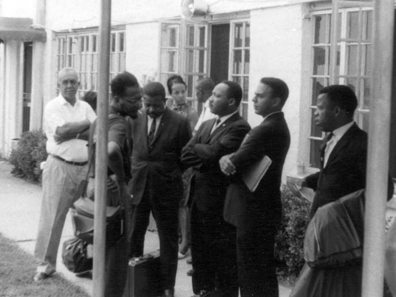 Civil rights leaders and workers gather at Greenwood Airport in Mississippi, July 1964. From left are Dewey Greene Sr., Mateo Suarez, the Rev. Ralph Abernathy Sr., Doris Derby, (unidentified man), the Rev. Martin Luther King Jr., Andrew Young Jr. and John Lewis. (Photo used with the permission of the Rev. Ed King, University Press of Mississippi and the Mississippi Department of Archives and History)