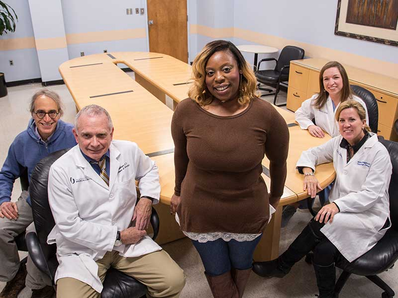 Tomeka Harps, center, visits with members of the medical team that helped save her life, from left, Dr. Stephen Raab, Dr. Kim Geisinger, Dr. Mildred Ridgway and Bethany Sabins.