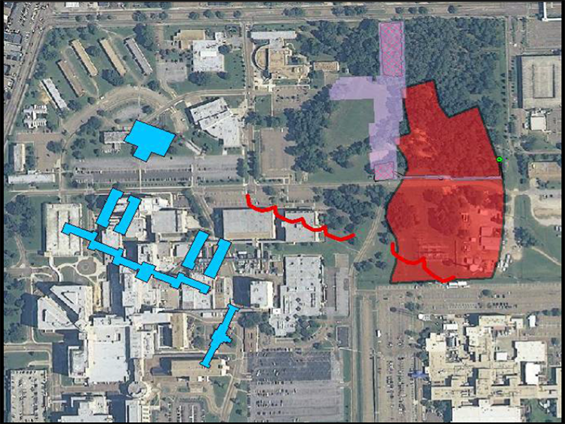 Modern aerial view of UMMC with historic overlay of Asylum main buildings (blue) and cemetery boundary (red)