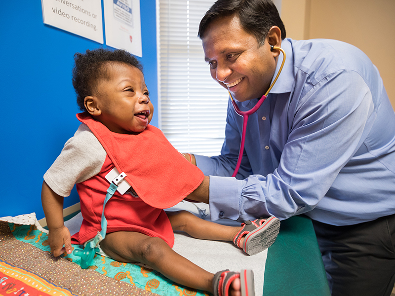 Jharad Faust laughs during a check-up with his pediatric cardiologist, Dr. Avichal Aggarwal.