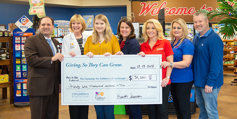 Celebrating the $31,000 Keith's Superstores donation are, from left, Collier Young, Dr. Phyllis Bishop, Bailey Sanderford, Natalie Hutto, Melissa Saucier, Virginia Catt and Richie Bullock.